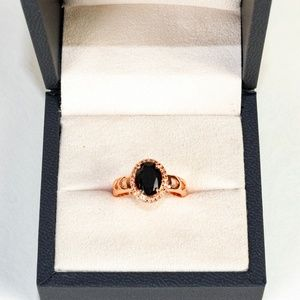 NWT Rose gold fantasy ring with a black stone